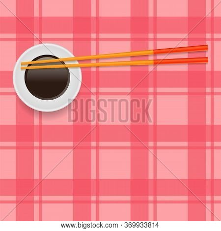 Soy Sauce And Traditional Colored Asian Chopsticks For Food On Red Square Background.