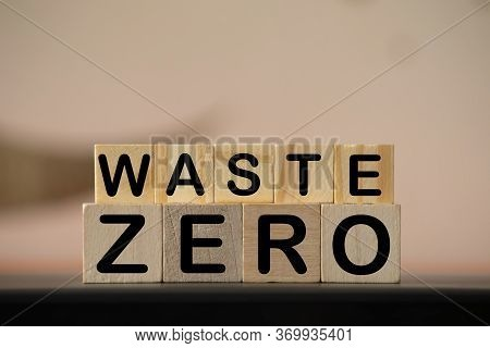 Zero Waste Letter, Word Cubes Over Blue Background. Environment Abstract Concept. Flat Lay.