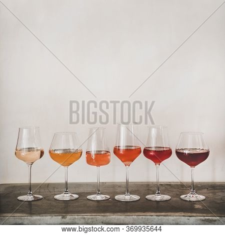 Various Shades Of Rose Wine In Stemmed Glasses, Square Crop