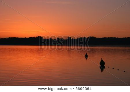 Beautiful Red Sunrise At The Island Herrenchiemsee, Part Of Lake Chiemsee (Germany),