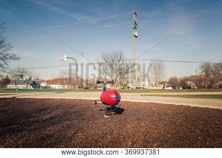 Rocking Toy On A Metal Spring In An Empty Public Playground
