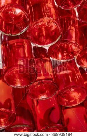 Wine Bottles Stacked In Drink Store. Many Stacked Glass Bottles With Volume Of 0.5 Liters Of Red Col