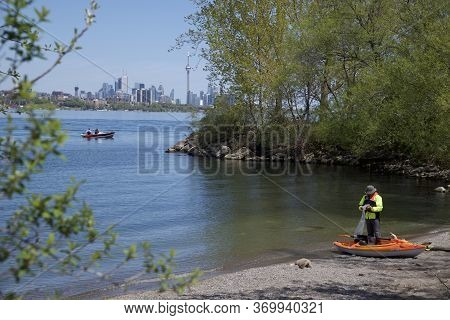 Toronto, Ontario / Canada - 05/21/2018: Doing The Final Check-up Before Launching The Kayak On Lake