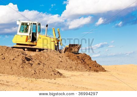 Bulldozer moving soil at construction site