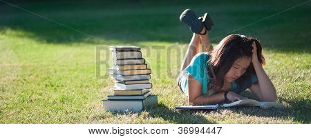 Young Asian Girl Studying Outside