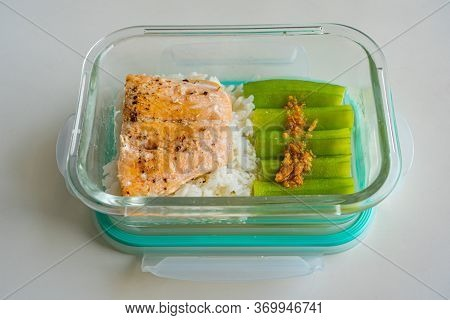 Diet Lunch Box With Baked Salmon, Steamed Okra And Rice