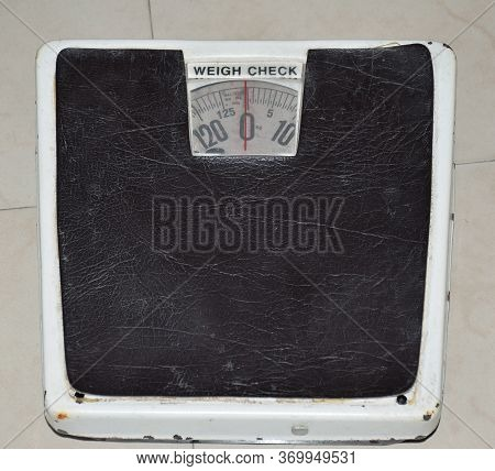 An Old Weighing Scale Or Machine. High Angle Shot