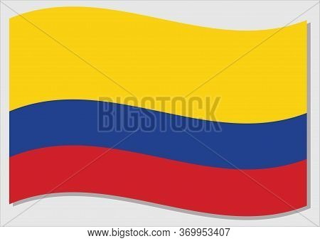 Waving Flag Of Colombia Vector Graphic. Waving Colombian Flag Illustration. Colombia Country Flag Wa
