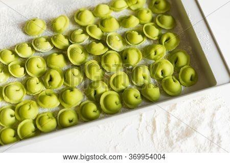The Process Of Sculpting Dumplings. Green Dumplings. Russian Dumplings
