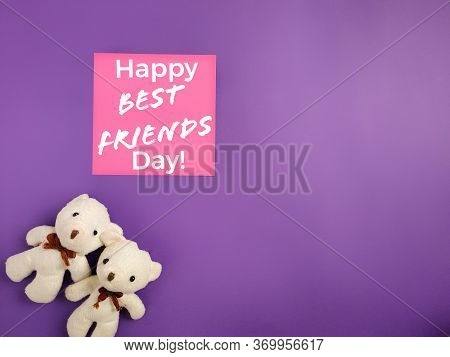 Friendship Celebration Concept - Happy Best Friend Day Text Written On Notepaper With Teddies Backgr