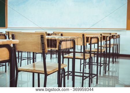 Lecture Room, School Empty Classroom With Desk Chair Iron Wood For Studying Lessons In High School.
