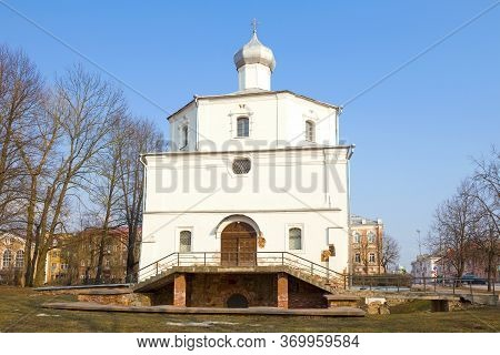 Ancient Church Of The Great Martyr George On Street Market Close Up On A Sunny April Day. Veliky Nov