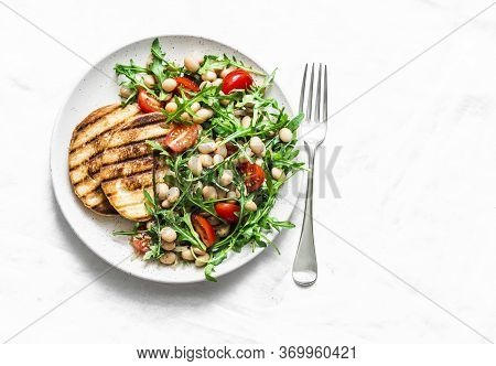 Beans, Rocket, Cherry Tomatoes Salad - Delicious Vegetarian Food On A Light Background, Top View