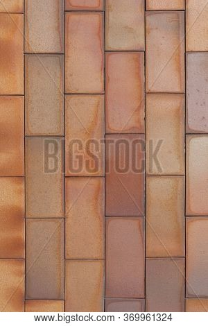Brick Tiled Brown Old Wall Made Of Symmetrical Blocks. Abstract Architectural Outdoor Background. Ve