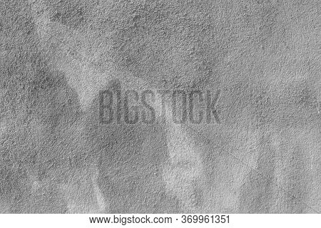 Cement Wall With Bumps And Spots. Abstract Gray Building Background For Design And Titles.