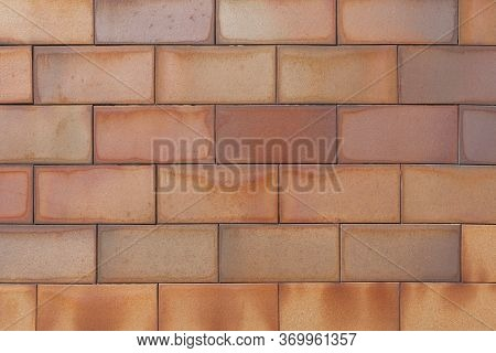 Brick Tiled Brown Old Wall Made Of Symmetrical Blocks. Abstract Architectural Outdoor Background