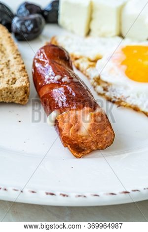 Bratwurst Sausage Filled With Emmental Cheese In Breakfast Plate.