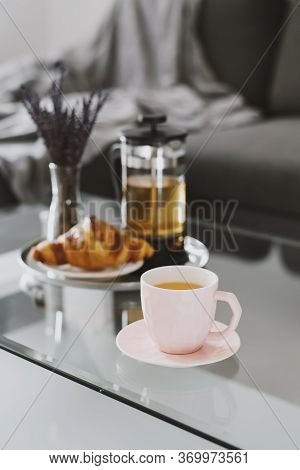 Herbal Tea And Fresh Croissant Served On A Metal Tray. Breakfast On A Coffee Table On Living Room