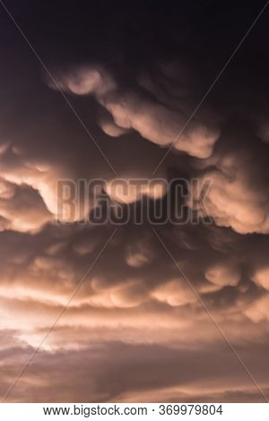 Mammoth Or Mastodon Clouds Over The Sky With Warm Tones