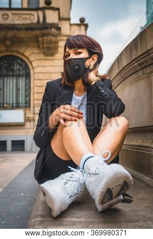 Streetstyle, A Young Brunette With A Face Mask From The Coronavirus Pandemic. Lack Of Confidence Aft