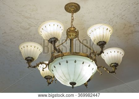 Light Fixture Antique Chandelier 7 Lights Solid Bronze Real Alabasters . Close-up Of A Beautiful Cry