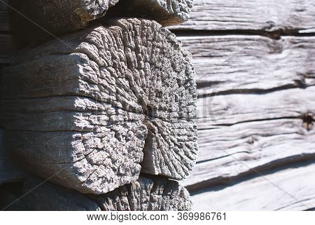 Close-up Of The Corner Of An Old Strong Shed. Corner Of A Wooden Peasant House. Untreated Natural Wo