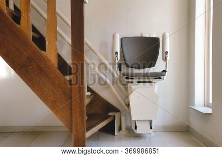 Automatic Stairlift On Staircase For Elderly Or Disability In A House,