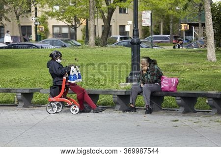 Bronx, New York/usa - May 18, 2020: Woman Observe Social Distance During Covid-19 Pandemic.