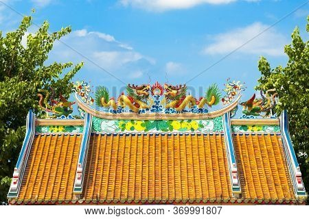 Dragons Duo Of Shrine On The Roof With Green, Blue Sky  Background.