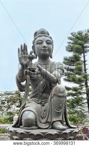Buddhist Deva Statue Offering Gifts To The Tian Tan Big Buddha  Statue On Lantau Island, Hong Kong