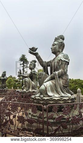 Buddhist Deva Statues Offering Gifts To The Tian Tan Big Buddha  Statue On Lantau Island, Hong Kong