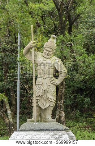 Statue Of General Indra, One Of The Twelve Divine Generals, On Lantau Island, Hong Kong