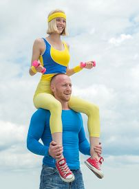 Fitness Couple Piggyback Ride. Young Sporty Sexy Couple Workout. Fitness Young Sporty Couple With Du