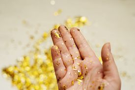 Gold Sparkles In The Palm Of Your Hand.