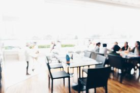 Abstract Blurred Bokeh People Sitting In Hotel Restaurant