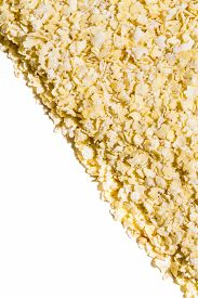 Close Up. Dry, Raw  Yellow Millet Flakes Frame On White Background