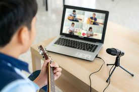 Asian Boy Playing Acoustic Guitar Virtual Happy Hour Meeting For Play Music Online Together With Fri