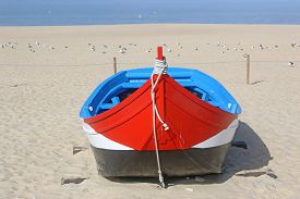 Traditional Fishing Boats On Nazare Beach, Portugal