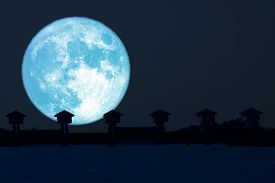 Super Blue Moon And Silhouette Dam In The Night Sky