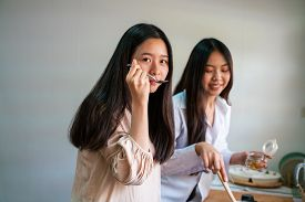 Happy Asian Women Cooking In Kitchen Together Morning Meal Friendships Make Food
