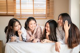 Group Of Beautiful Asian Women Lying On Bed Laughing And Talking Together On Cozy Bed Fashionable Mo