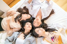 Fashion Beautiful Women Group Meeting On Bed