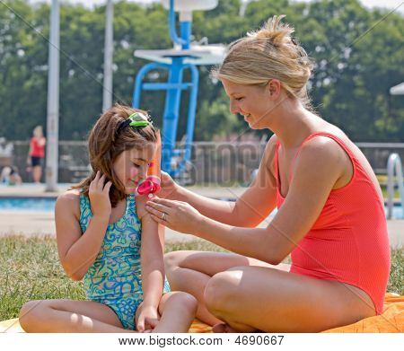 Mother And Daughter At The Pool