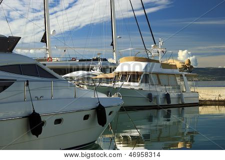 Luxury Yachts Moored On Pier