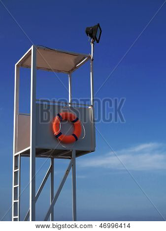Lifeguard Tower On A Background Of Blue Sky