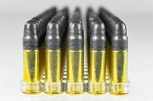 Group of bullets isolated on white background poster