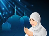 Young Muslim girl in traditional dress(hijab) praying(reading Namaz, Islamic Prayer) on shiny blue background with mosque. poster