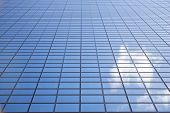 sky and cloud reflected in facade of office building Delftse Poort in Rotterdam poster