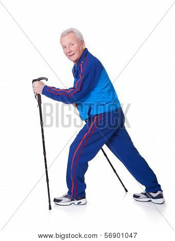 Senior Man Walking With Hiking Poles