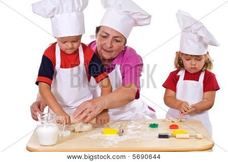 Grandmother Teaching Kids How To Make Cookies
